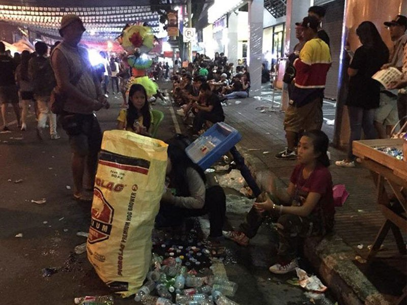 "The sale of single-use water bottles is common practice for the convenience of festival-goers but disposal and recovery remain to be ""swept aside"" on the streets during and after the festival. (Charley Sta Maria)"