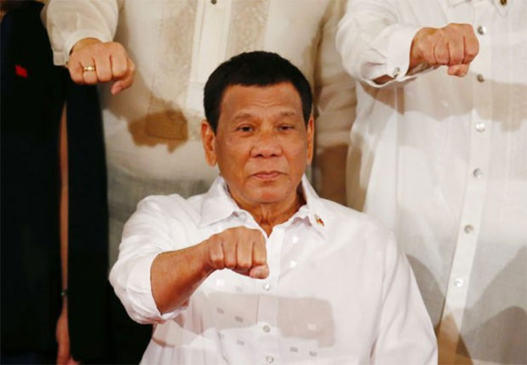 MANILA. President Rodrigo Duterte gestures with a fist bump after addressing congressmen and government officials at the presentation of Republic Act bills ceremony at the Presidential Palace in Manila, Philippines, on October 9, 2018. (AP)