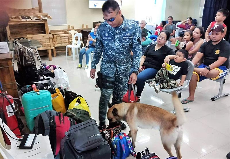BACOLOD. A K-9 dog inspects the baggage of passengers at the Bredco port Tuesday, October 30. (Contributed Photo)