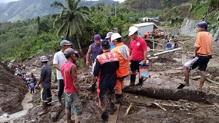 MOUNTAIN PROVINCE. In this image provided by the Department of Public Works and Highways-Mountain Province District Engineering Office, rescuers dig through the earth to search for survivors after a massive landslide in Natonin, Mountain Province, on October 31, 2018. (AP)