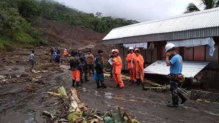 MOUNTAIN PROVINCE. In this image provided by the Department of Public Works and Highways-Mountain Province District Engineering Office, rescuers prepare to dig through the earth to search for survivors after a massive landslide, set off by Typhoon Rosita, crashed down on two government buildings in Natonin, Mountain Province, on October 30, 2018. (AP)
