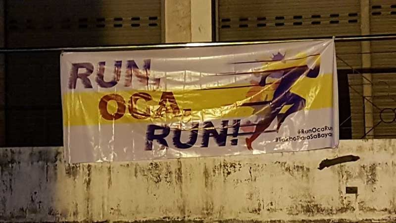 PAMPANGA. A tarpaulin sign hung on the fence of the Arnedo Park at Capitol urges former representative and mayor Oscar Rodriguez to run for mayor in the City of San Fernando. (JTD)
