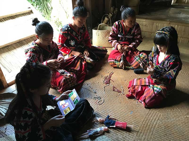 SOUTH COTABATO. A group of Tboli children and a guest garbed in their attire dress up dolls in beads and traditional Tboli textile at the School of Living Traditions in Lake Sebu, South Cotabato. (Photo by Stella A. Estremera)