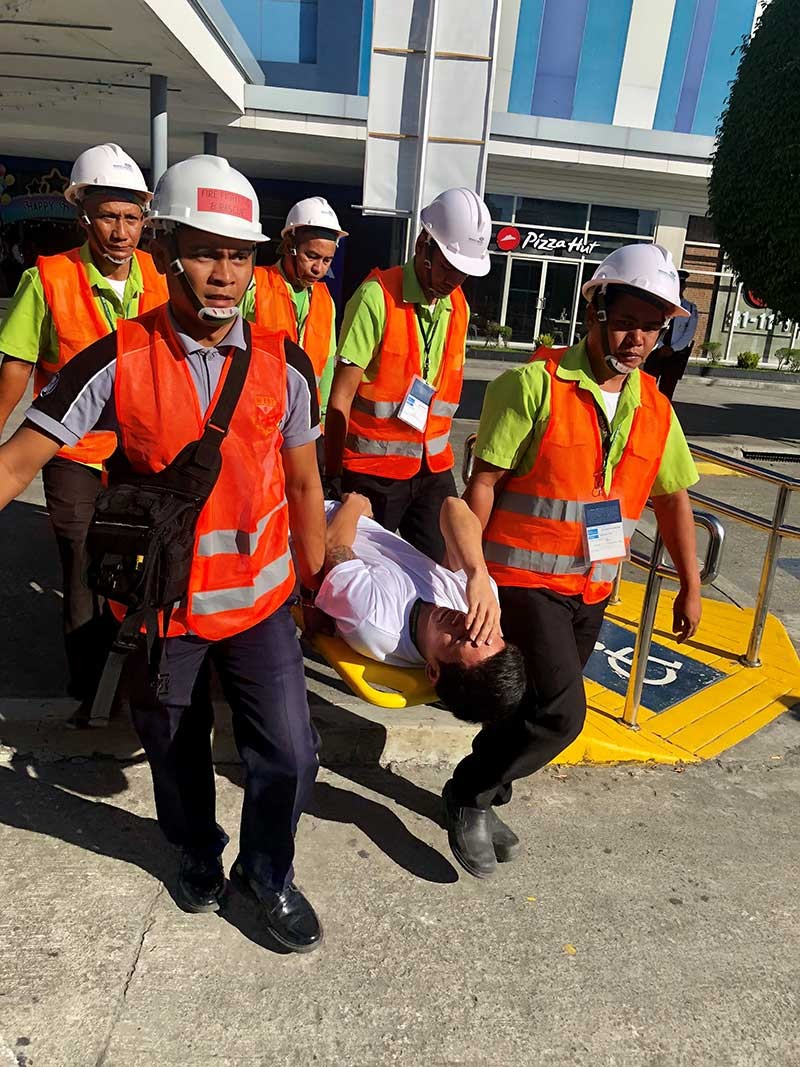 EARTHQUAKE DRILL. Trained security guards of SM City Clark in a simulation of rescue in the earthquake drill. (Contributed Photo)