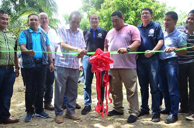 ILOILO. Governor Arthur Defensor Sr. leads the groundbreaking of the 4-kilometer pathway from Brgy. Jayubo to Brgy. Cabatangan Proper in Lambunao amounting to P19.371-million. Also in the photo are Mayor Jason Gonzales and DENR-Western Visayas executive director Jim Sampulna (Contributed photo)
