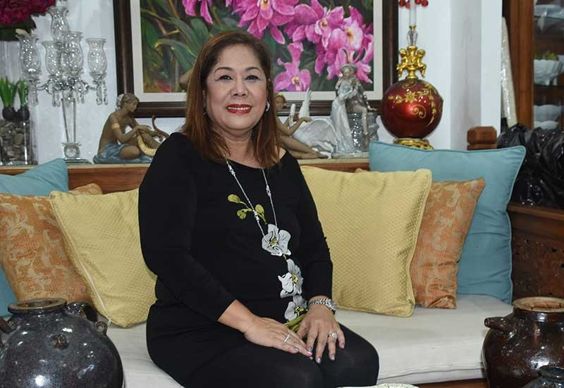 SURROUNDED BY BEAUTIFUL THINGS. Nene Treveño says selling comes naturally to her. From perfume and makeup, she has made a name for herself in the arts and antiques scene. (SunStar photo/Allan Cuizon)