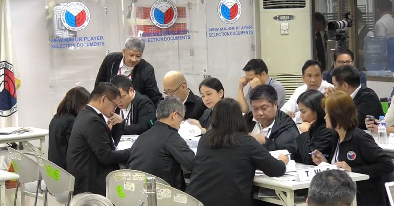 MANILA. The Technical Working Group evaluates the selection documents of three bidders for the new major player in the telecommunications industry on Wednesday, November 7, 2018. (Photo grabbed from DICT Facebook)