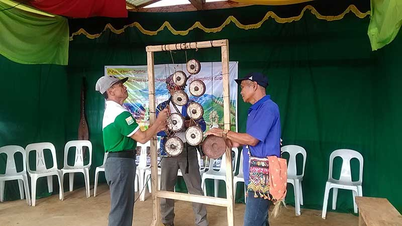 Men playing their standing kulintang which requires right timing and rhythm with the person playing the base. (Contributed photo)
