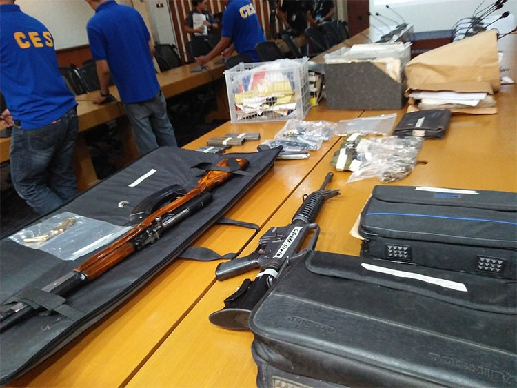 MANILA. Firearms and other items seized from National Democratic Front of the Philippines consultant Vic Ladlad. (Third Anne Peralta-Malonzo)