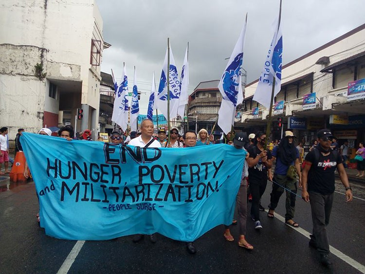 TACLOBAN. Members of the People Surge march in Tacloban City to demand justice for what they say as