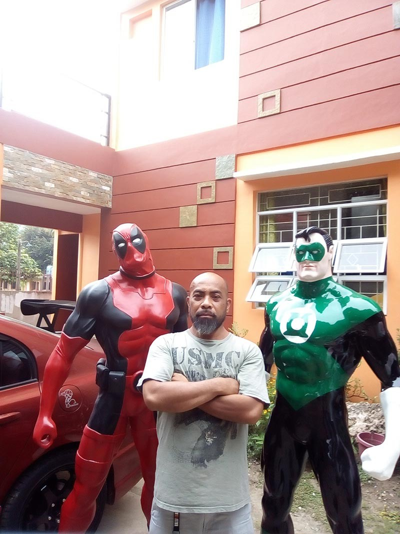 CAGAYAN DE ORO. Demver Morales together with the life-size statues of superheroes he created. (Photos from Demver Morales' Facebook account)