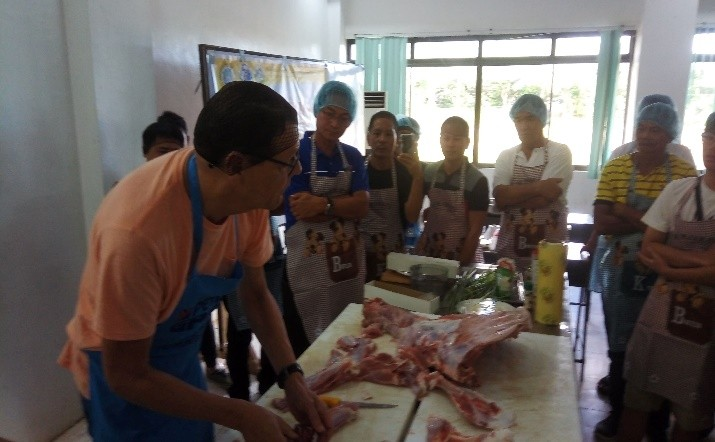 SAGAY. PUM senior expert Jan Van Goor (left) demonstrates to the participants the proper deboning of mutton and veil during the skills enhancement and development training on butchery held at Balay Kauswagan in Sagay City on Wednesday. (Contributed Photo)