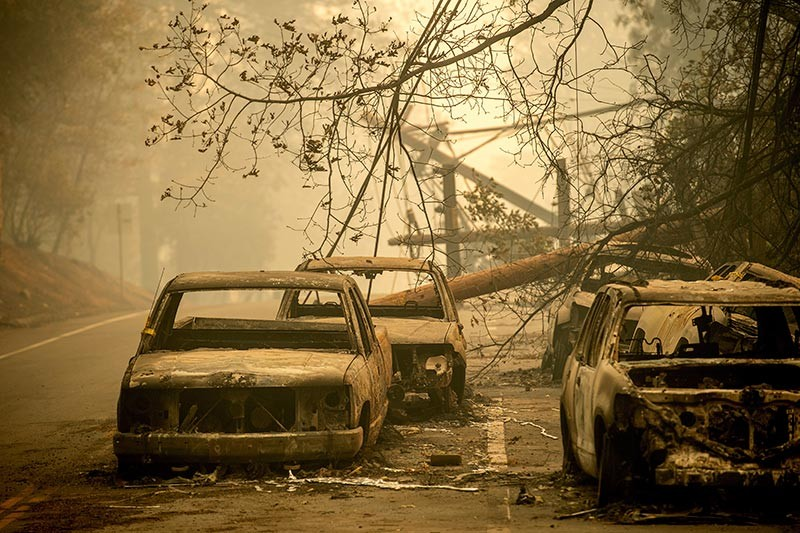 Abandoned cars, scorched by the wildfire, line Pearson Rd. in Paradise, Calif., on Saturday, November 10, 2018. Not much is left in Paradise after a ferocious wildfire roared through the Northern California town as residents fled and entire neighborhoods are leveled. (AP Photo/Noah Berger)