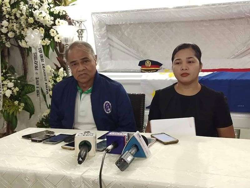 BACOLOD. Michelle Rapiz, along with legal counsel Tranquilino Gale, in a press conference at the Rolling Hills Memorial Chapel, where the late superintendent Santiago Rapiz lies in state, on Saturday, November 10.