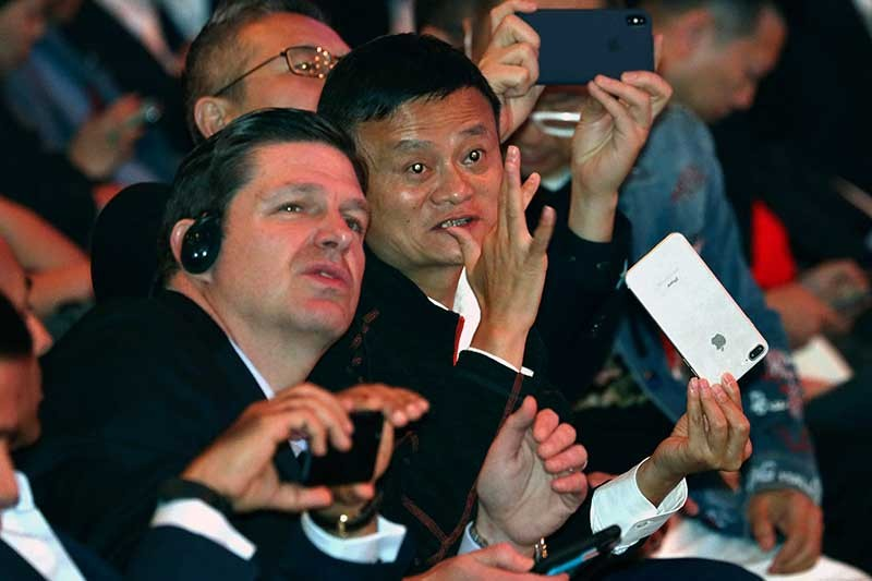 CHINA. Jack Ma, Alibaba's chairman, chats after the start of Alibaba's 11.11 Global Shopping Festival held in Shanghai, China, early Sunday, Nov. 11, 2018. (AP)