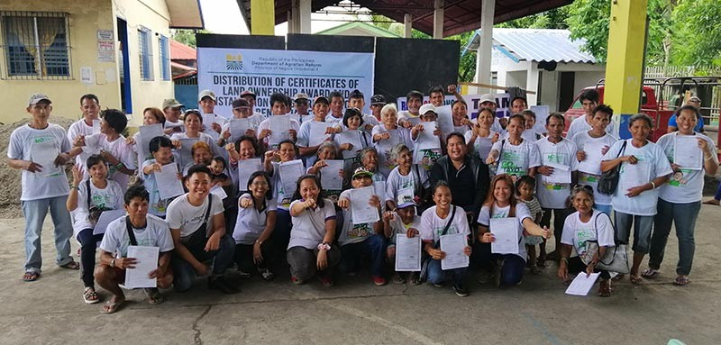 BACOLOD. Municipal Agrarian Reform Program Officer Tessie Pedrosa (3rd from left) with farmer-beneficiaries, and other attendees during the distribution of Cloas and installation rites in E.B. Magalona town on Monday, November 12.(Contributed Photo)