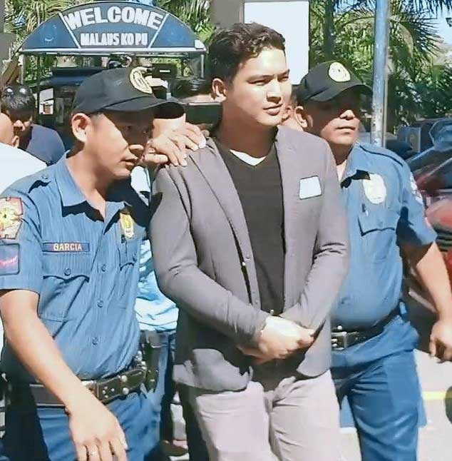PAMPANGA. Police officers accompany road rage suspect Jojo Serafico Valerio to the Angeles City Police Station 4 after his arrest on Wednesday, November 14, 2018. (Contributed Photo)