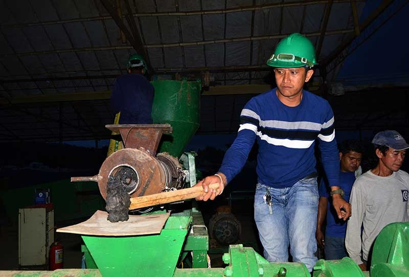 A Verde Soko Phil. Industrial Corp. worker checks the clump of plastic that underwent a recycling process at the company's facility in Sitio Buguac, Barangay Santa Cruz, Tagoloan. Verde Soko will produce pellets and briquettes which it will export to China and South Korea and will be made into plastic furniture and other items. (Jigger J. Jerusalem)