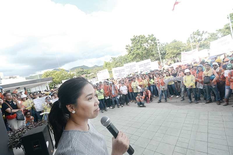 City of naga mayor kristine vanessa chiong talks to some of the Apocemco employees protesting the loss of the jobs of some 400 employees. (SunStar photo/Amper Campaña)
