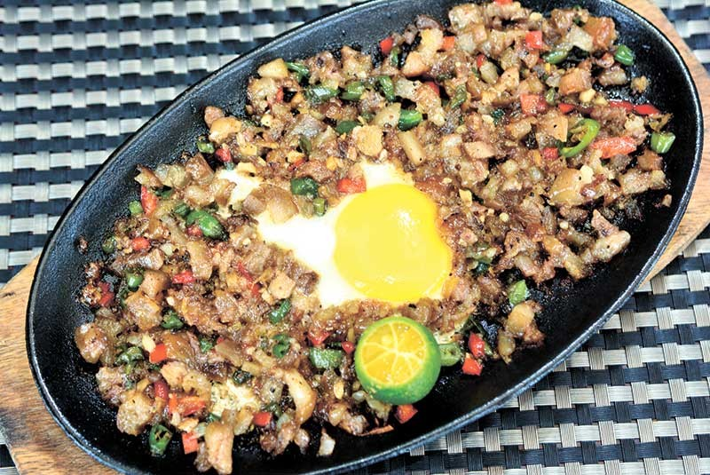 FILIPINO FOOD BEYOND LECHON. Made of chopped pig's head and liver, sisig is a popular dish in many Filipino restaurants. (SunStar file photo)