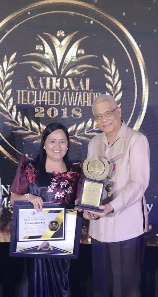 BACOLOD. Negros Occidental Language and Information Technology Center Vocational School Administrator Ma. Cristina Orbecido (left) receives the awards from Department of Information and Communications Technology Secretary Eliseo Rio during the National Tech4Ed Awards 2018 awarding rites held at the Royal Mandaya Hotel in Davao City on November 15. (Contributed Photo)