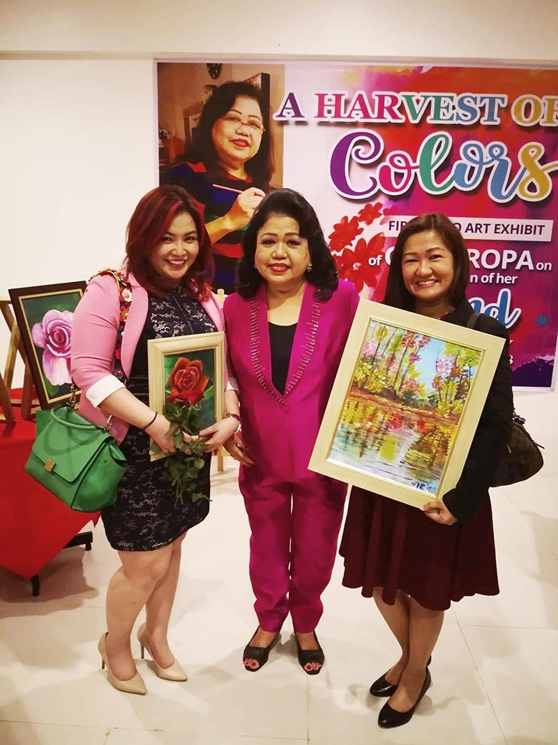 """DAVAO. Judge Jill Jaugan-Lo with the artist's """"A Rose"""" and Judge Estrellita Tolentino-Roxas with """"First Landscape"""". (Vinky Europa)"""