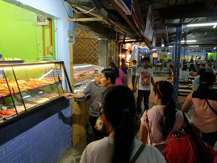 Customers check out the food during the soft opening of Larsian Food Street last Nov. 8. The popular barbecue place officially reopened Friday, Nov. 16, with new rules and regulations for stall owners, food handlers and servers. (SunStar Foto / Arni Aclao)