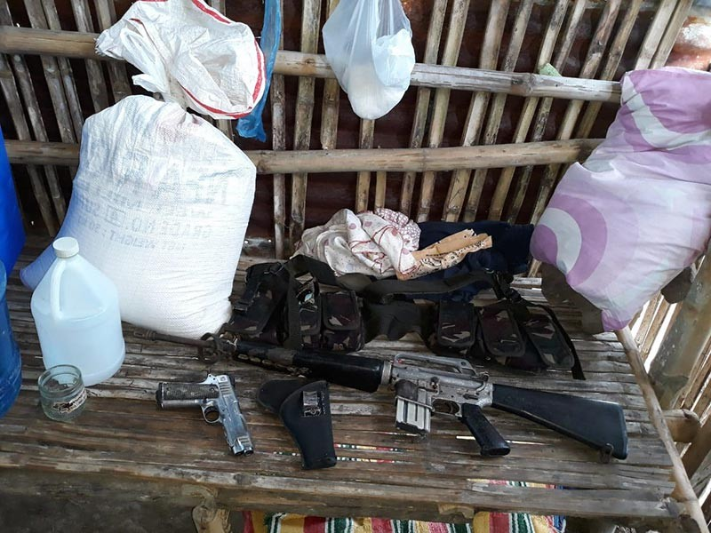 BACOLOD. Government troopers recover some firearms, ammunition, subversive documents, and other belongings at the clash site at Barangay Washington, Escalante City on November 16.