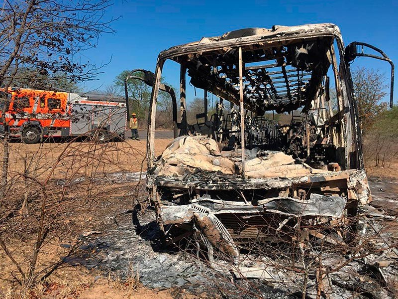 ZIMBABWE. A fire engine is parked near to a burnt out bus after a bus accident in Gwanda about 550 kilometres south of the capital Harare, Friday, Nov. 16, 2018. Police in Zimbabwe say more than 40 people have been killed in a bus accident on Thursday night. (AP)