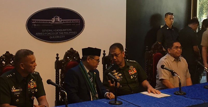 MANILA,. Armed Forces of the Philippines Chief of Staff Carlito Galvez Jr. and Moro Islamic Liberation Front chairman Al Haj Murad Ebrahim talk during the latter's visit to Camp Aguinaldo on November 19, 2019.  (Third Anne Peralta-Malonzo/SunStar Philippines)