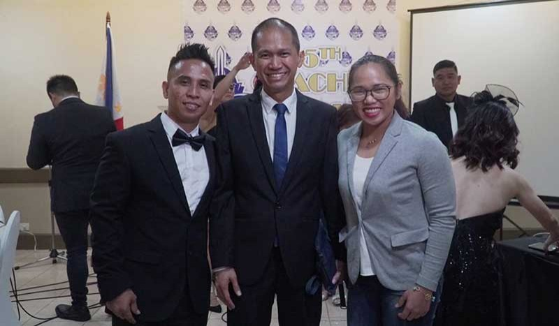 DAVAO. Catalino Diaz, Jr., left, is the cousin and first coach of Rio Olympics silver medalist Hidilyn Diaz, right. Both attend the Ateneo de Davao University 5th Coaches' Banquet at the Apo View Hotel Saturday evening. Also in photo is Addu athletics director Noli Ayo. (Photo courtesy from Hidilyn Diaz Oly Facebook page)