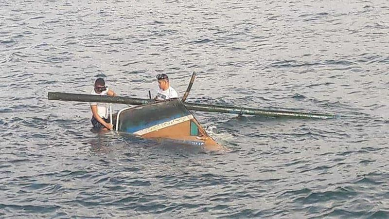 Personnel of the Philippine Coast Guard-Negros Occidental tow the capsized boat. (Contributed photo)
