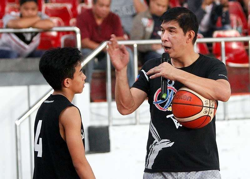 BAGUIO. Coach Jong Uichico gives pointers to participants of the two-day coaching clinic at the University of Baguio gym over the weekend conducted by the Samahang Basketbol ng Pilipinas (SBP). (Jean Nicole Cortes)