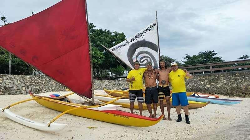 NEW RIDE. From left, Buzzy Budlong of Island Buzz Philippines, Hawaiian legendary paddler Kimokeo Kapahulehua, Gary Benedicto and Randy Salazar pose with the Maharlika Big 6. (Contributed photo/Randy Salazar)
