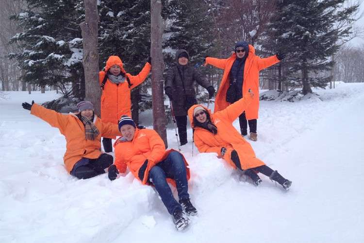 Mount Usu. The author (foreground, extreme right), with her companions (clockwise, from foreground center) Mark, Melanie, Rose Marie, Carolyn and Lucille, wears seven layers of clothing to keep from freezing. (Photo /  Melanie Lim)