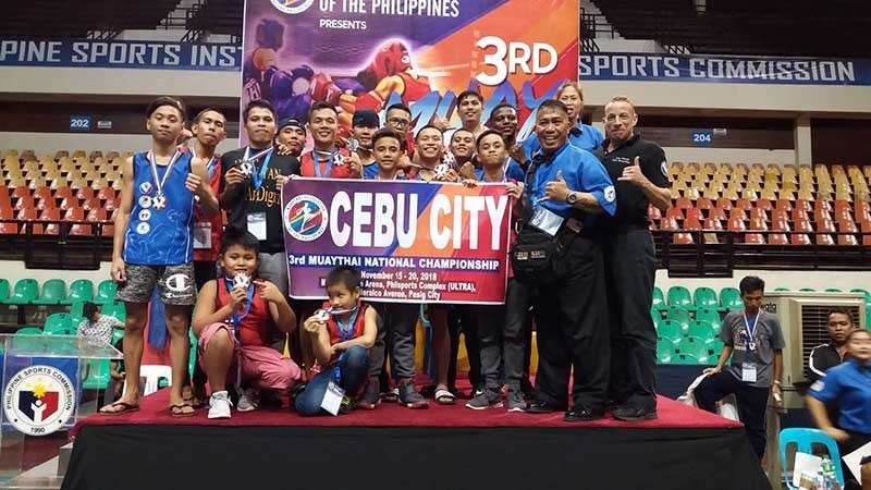 GREAT SHOWING. Master Ekin Cañiga and the members of Team Cebu City celebrate after the 3rd Muay Thai National Championship. (Contributed photo)