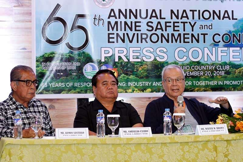 RESPONSIBLE MINERS. Doctor Walter Brown, president of the Philippine Mine Safety and Environment Association (PMSEA) addresses issues and clarifies misconception about the mining industry during a press conference for the Annual Mine Safety and Environment Convention. With him are PMSEA Directors Ramon Santiago and Cornelo Casido. (Jean Nicole Cortes)