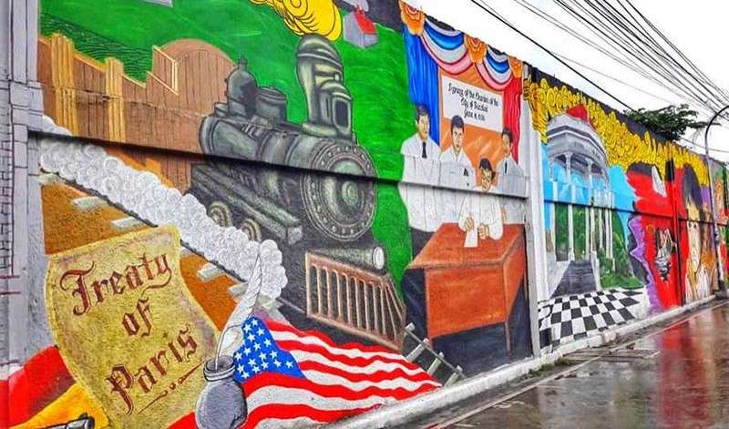 BACOLOD. A portion of the Bacolod Historical Mural at Burgos Street. (Mark Chavez)