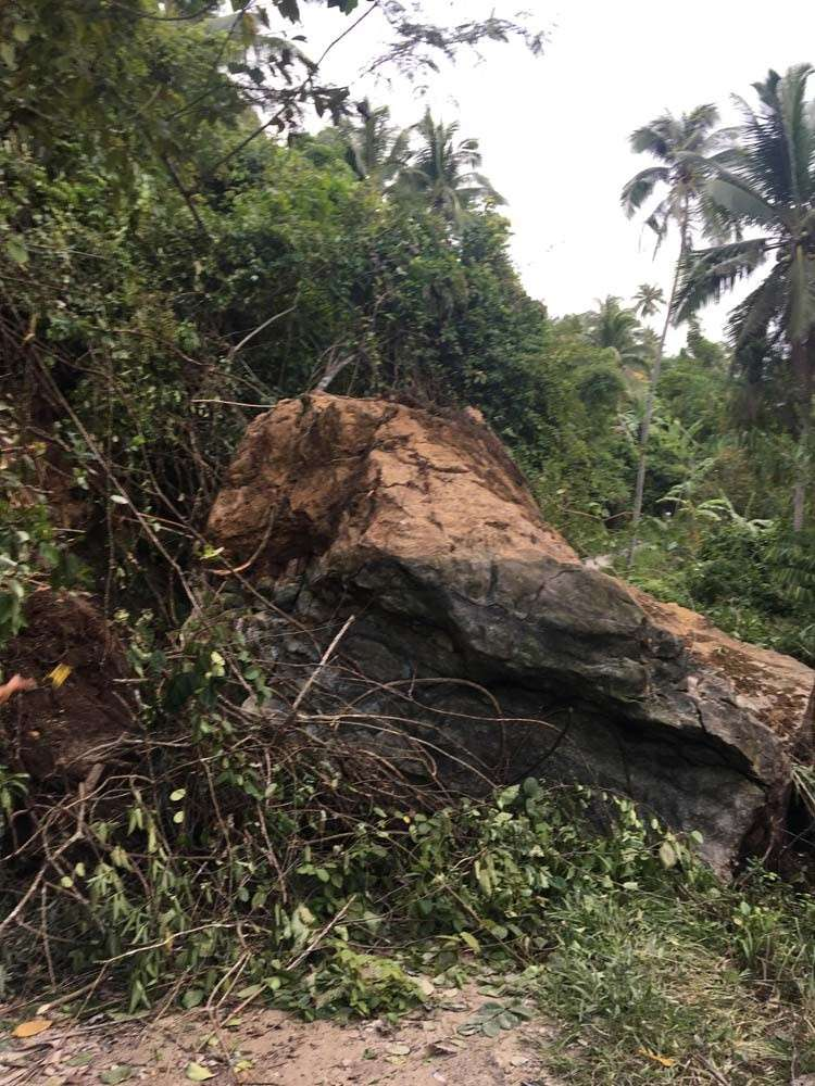 CEBU. Large boulder falls on a barangay road in Sibonga, affecting the movement of vehicles. (Photo courtesy of PDRRMO)