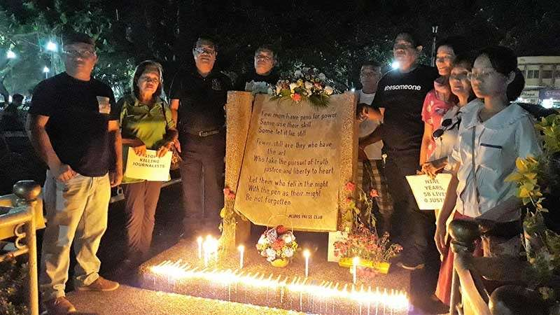 BACOLOD. Local media organizations, the victims' kin, students, and various groups hold a candle-lighting activity at the Marker for Fallen Journalists in the public plaza in Bacolod City Friday to commemorate the 9th year anniversary of the Ampatuan massacre, which killed 58 people including 32 journalists on November 23, 2009 in Maguindanao.  (Marchel Espina)