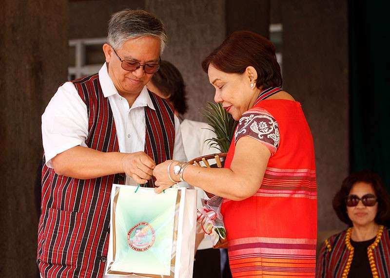 BAGUIO. Senator Cynthia Villar receives a token from Benguet Governor Crescencio Pacalso after her talk during the 118th Foundation anniversary and 2018 Adivay Festival of the province. (Jean Nicole Cortes)