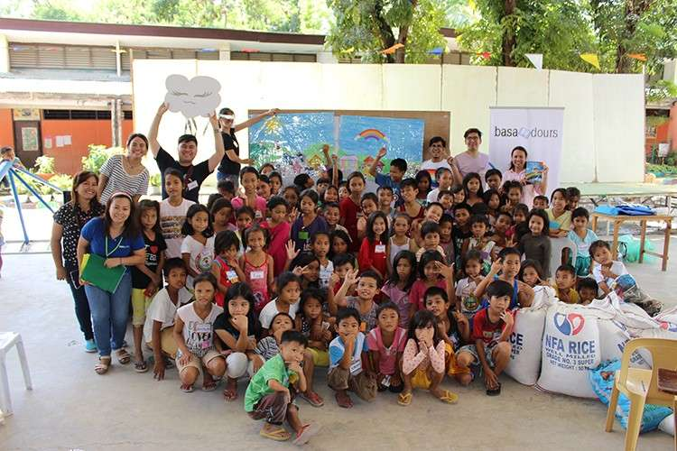 Stories of hope. Volunteer-members of Basadours Inc. impart the values of cleanliness and environmental consciousness through storytelling activities for the children of the City of Naga. (Contributed Photo)