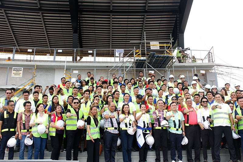 PAMPANGA. National athletes and government officials flash the Duterte fist sign after checking out the ongoing construction of sports facilities in New Clark City in Capas, Tarlac on Friday. (Contributed Photo)