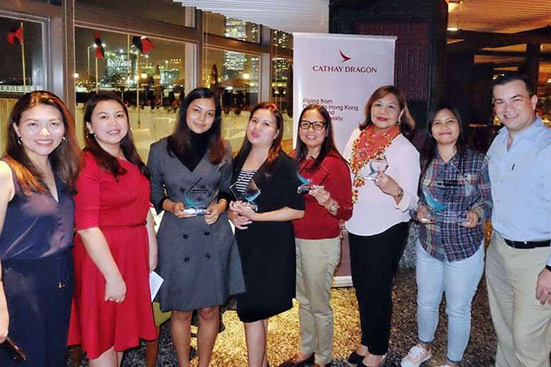 HONG KONG. Cathay Pacific's top agents from Mindanao recognized by Cathay Pacific's Cecil Marcelo; district sales and marketing manager, Hazel Tagimacruz; and PH Country President, Rob Bradshaw
