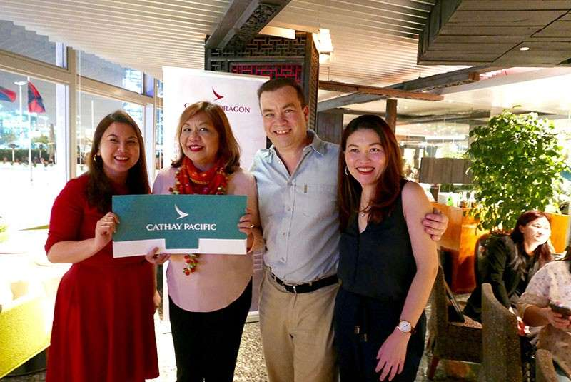 HONG KONG. Bing Pasquil of PanAsia Tours & Travels winning a Business Class ticket to Japan