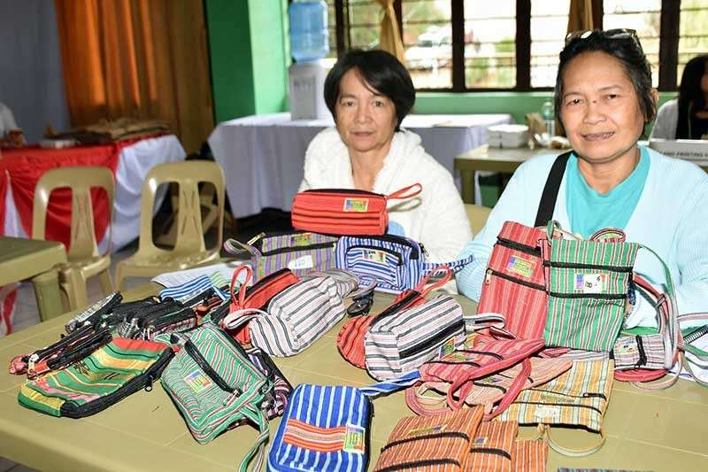 Alternative. Golden Livelihood Association President Milagros Fermin and Business Manager Carmencita Wakit presents during the Adivay MSME Summit in La Trinidad, Benguet handcrafted bags and other items which were made by the small scale miners from Goldfields in Itogon, Benguet, that were affected by the recent stoppage order on mining operations. (Redjie Melvic Cawis)
