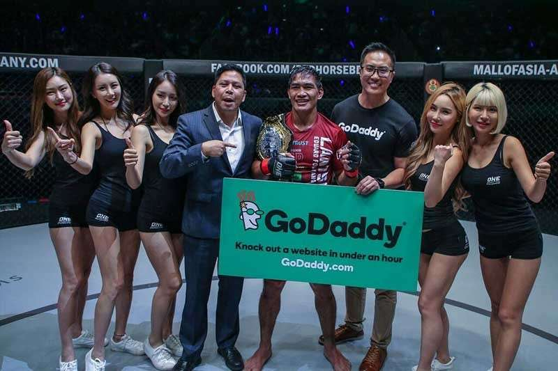 BAGUIO. After losing the title a year ago, Eduard Folayang reclaims the One Championship world lightweight title Friday evening to cap Team Lakay's dominance in the promotion this year. (One Championship photo)