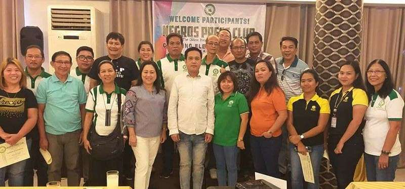 BACOLOD. Negros Press Club officers led by President Renato Duran (second row, 5th from left) with speakers lawyer Mavil Majarucon-Sia (first row, 4th from left) and Dr. Walter Yudelmo (first row, 5th from left), and participating media practitioners during the Covering Elections Seminar held at GT Hotel in Bacolod City Saturday, November 24. (Contributed photo)