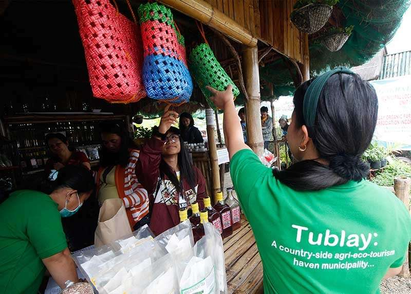 BENGUET. Locally-made products from the municipality of Tublay are showcased at the Adivay Trade Fair in Wangal, La Trinidad. Tublay, an agri-eco tourism haven, promotes Good Agricultural Practices and organic farming. (Jean Nicole Cortes)