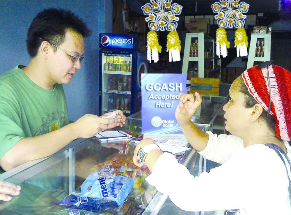 Embracing tech. A customer sends money through a GCash Remit service. A study on Southeast Asian micro, small and medium enterprises finds the level of digitalization is minimal.  SUNSTAR FILE